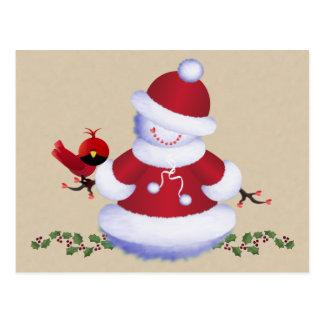 Postal linda del muñeco de nieve con el pájaro