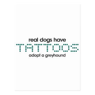 Postal Los perros reales tienen tatuajes