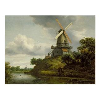 Postal Molino de viento por un río