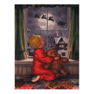 Postal Muchacho del vintage que mira a Papá Noel volar