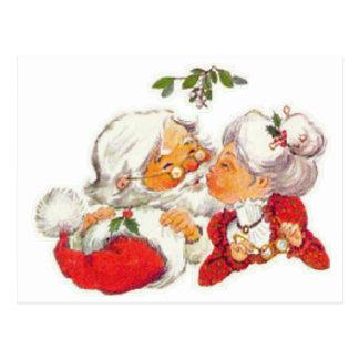 Postal Navidad Santa del vintage que besa a señora Claus