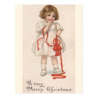 Postal Niña del vintage con la cinta del navidad