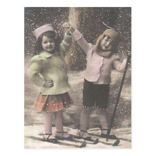 Postal-niños del navidad del vintage en los esquís