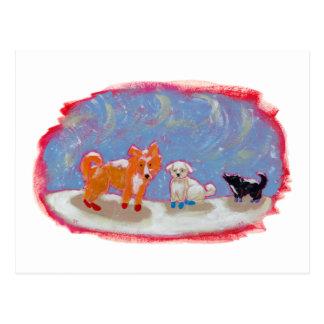 Postal Perros en escena linda de la nieve del invierno