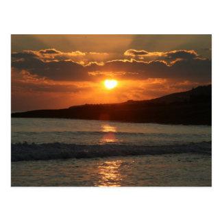 Postal Puesta del sol en la playa de DA Luz del Praia,