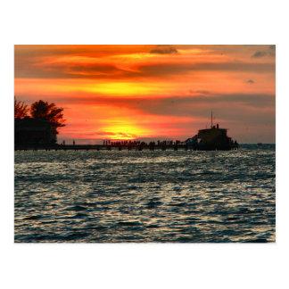 Postal Rod y embarcadero del carrete en la puesta del sol