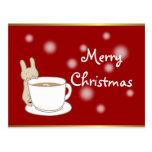 Postal roja de las Felices Navidad del conejo y de