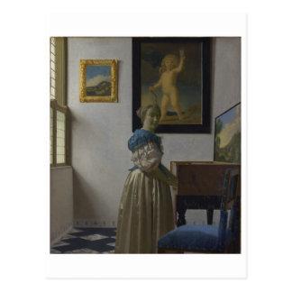 Postal Señora Standing en un Virginal de Juan Vermeer