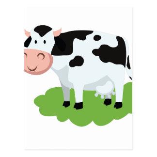 Postal vaca de ordeño en el jardín
