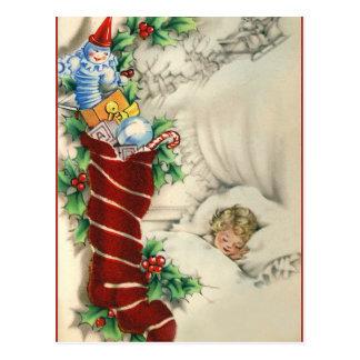 Postal vintage de un niño soñando con la Navidad