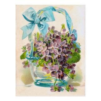 Postal Violetas en una cesta de cristal