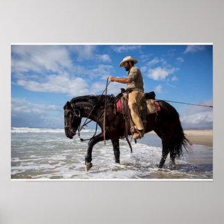 Póster Fijar cow boy caballo en el mar