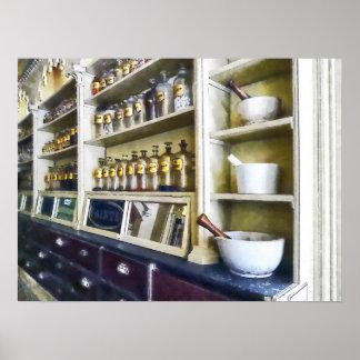 Póster Tres mortero y majas en farmacia