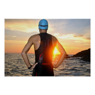 Póster young athlete triathlon in front of a sunrise