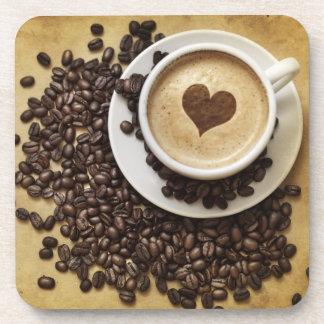 Práctico de costa de la bebida del amor del té de  posavasos de bebida