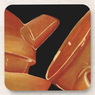 Prácticos de costa anaranjados del juego de té posavasos