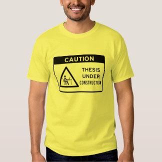 Precaución: Tesis bajo construcción (texto negro) Camiseta