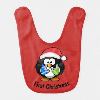 Primer babero del pingüino del navidad