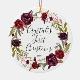 Primer ornamento del navidad de la niña floral