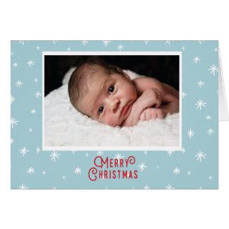 Primera tarjeta de Navidad del bebé con los copos