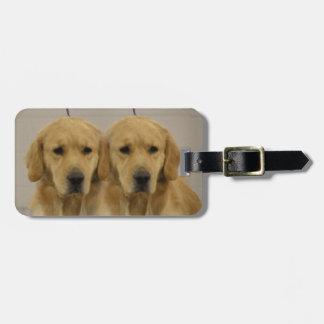 Primero del equipaje de los gemelos del golden ret etiquetas para maletas