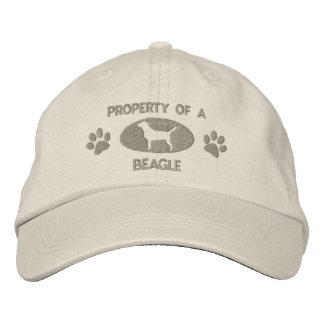 Propiedad de un gorra bordado beagle gorra de beisbol