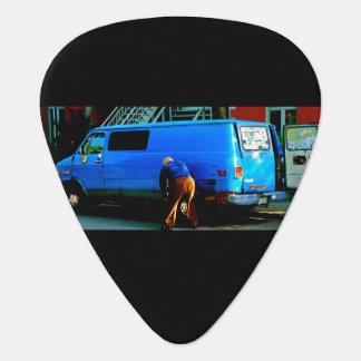 Púa De Guitarra Neumático cambiante del hombre en Montreal
