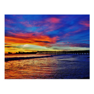 Puesta del sol de la playa de Seacliff. Santa Postal