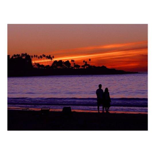 Puesta del sol de la playa postal