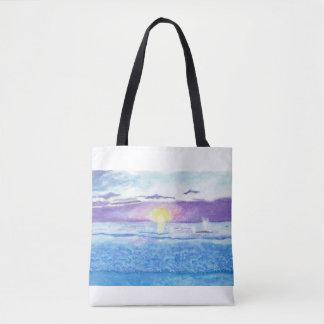 Puesta del sol del océano con el bolso de la