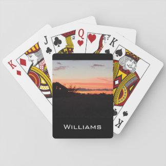 Puesta del sol en la granja barajas de cartas