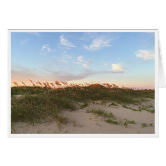 Puesta del sol en la playa tarjeta de felicitación