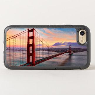 Puesta del sol hermosa del invierno en puente funda OtterBox symmetry para iPhone 7