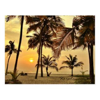 Puesta del sol por el mar postal