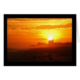 Puesta del sol que pasa por alto Emerald Isle Tarjeta