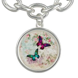 Pulseras Con Dijer Mariposas rosadas y verdes en rosas lamentables