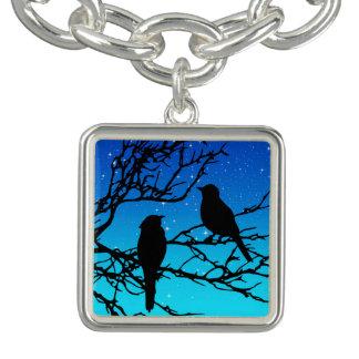 Pulseras Pájaros en una rama, negra contra la igualación