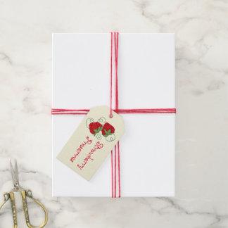 Puntada cruzada de las fresas de los cotos de etiquetas para regalos