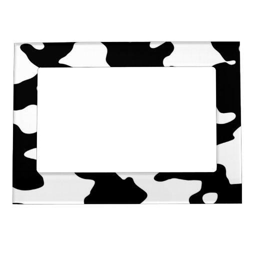 Puntos blancos y negros del modelo de la vaca marcos magneticos para fotos