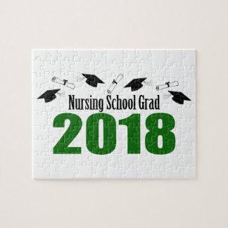 Puzzle Casquillos y diplomas (verde) del graduado 2018 de