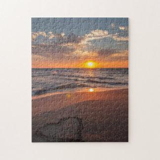 Puzzle Corazón de la salida del sol en arena