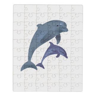 Puzzle Dos delfínes tropicales que saltan al lado de uno