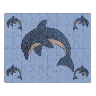 Puzzle El grupo que salta delfínes blancos azules de la
