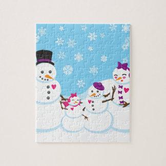 Puzzle Familia de la nieve del invierno