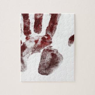 Puzzle Handprint de la sangre del asesino en serie