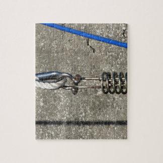 Puzzle Honda de la cuerda con el grillo de ancla de la
