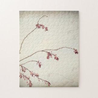 Puzzle La rama de árbol de ciruelo con la primavera