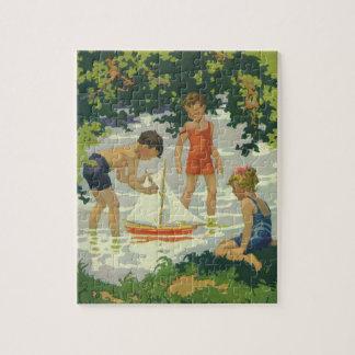 Puzzle Niños del vintage que juegan la charca del verano