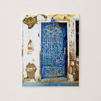 Puzzle Puerta vieja del azul de Grecia del vintage