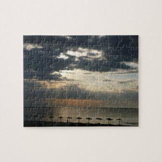 Puzzle Salida del sol sobre la playa en la fotografía de